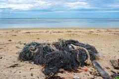 Сеть рыболова на пляже Стоковые Изображения