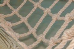 Сеть толстых веревочек с узлами Стоковое Фото