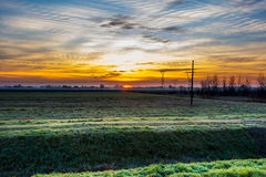 Сельская местность на восходе солнца Стоковые Изображения