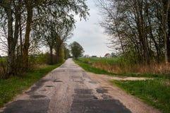 Сельская дорога идя в поле Стоковая Фотография RF