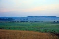 Сельский ландшафт на сумраке Стоковое Изображение