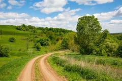 Сельский поворот дороги Стоковые Фотографии RF