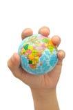 сжатая рука глобуса Стоковая Фотография RF