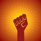 Сжатый кулак, который держат в концепции протеста Стоковые Фото