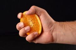 Сжимать половинный апельсин Стоковые Изображения RF