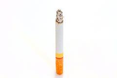 Сигарета ожога на белизне Стоковые Фотографии RF