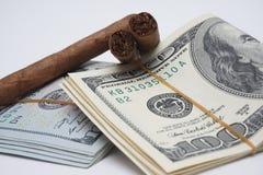 Сигары и наличные деньги Стоковые Изображения RF