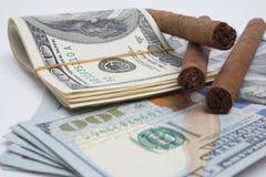 Сигары и наличные деньги Стоковое Изображение