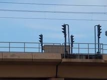 Сигналы на светлой железной дороге Стоковые Изображения