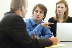 сидите работники беседы Стоковое Фото