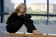 сидя женщина Стоковое Изображение