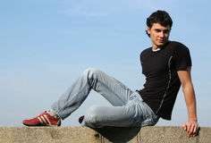 сидя подросток стоковая фотография rf