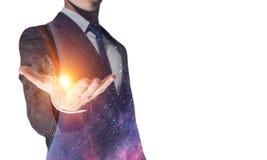 Сила космоса в руках стоковое фото