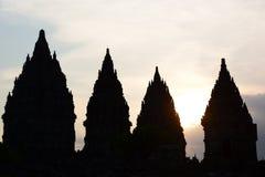 Силуэты висков на заходе солнца Prambanan Область Yogyakarta java Индонезия стоковое фото rf