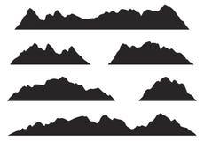 Силуэты гор на белой предпосылке Стоковые Изображения