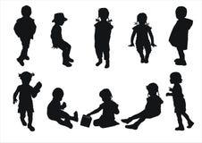 силуэты малышей Стоковые Изображения RF
