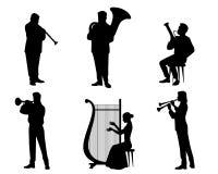 Силуэты музыкантов оркестра Стоковая Фотография RF