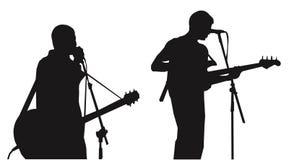 силуэты музыкантов Стоковое фото RF