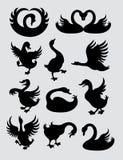 Силуэты утки и лебедя Стоковое фото RF