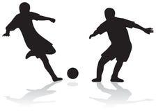 силуэты футбола Стоковое фото RF