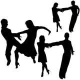 силуэты latino танцульки Стоковые Фото