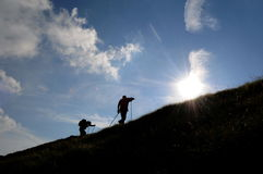 силуэты trekking Стоковые Изображения
