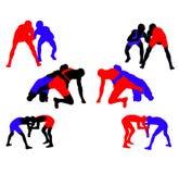 силуэты vector wrestling Стоковые Изображения RF