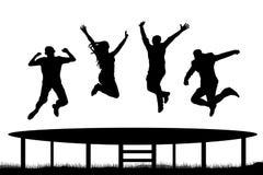 Силуэт батута людей скача Стоковые Изображения