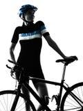 Силуэт велосипеда катания велосипедиста задействуя изолированный женщиной Стоковое фото RF