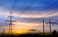Силуэт высоковольтных линий электропередач Стоковая Фотография
