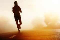 силуэт дороги спортсмена идущий Стоковое фото RF