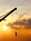 Силуэт крана на заходе солнца Стоковые Фото