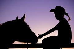 силуэт лошади ковбоя Стоковое Изображение RF