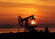 Силуэт на заходе солнца Стоковые Фото