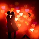 Силуэт пары в влюбленности целуя против сердца запачкал предпосылку, иллюстрацию вектора Стоковая Фотография RF
