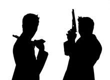 Силуэт пар людей с пистолетами Стоковое фото RF