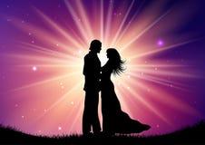 Силуэт пар свадьбы на предпосылке starburst стоковое фото