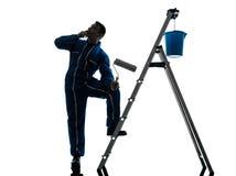 Силуэт работника колеривщика дома человека Стоковые Изображения RF