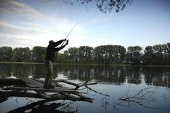 Силуэт рыболова стоковое фото rf