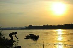 силуэт рыболова Стоковая Фотография