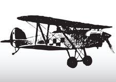силуэт самолет-биплана Стоковые Изображения RF