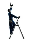 Силуэт сверла удерживания рабочий-строителя человека Стоковое Фото