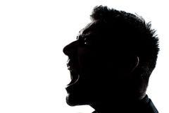 силуэт сердитого профиля портрета человека кричащий Стоковое фото RF