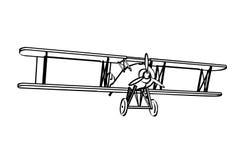 Силуэт старого самолет-биплана Стоковое фото RF