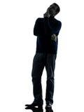Силуэт человека сомнительный думая полнометражный Стоковое Изображение RF