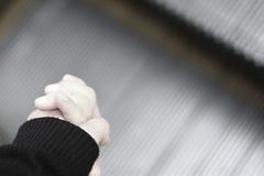 Сильная рука держа меньшую руку стоковое фото rf