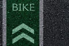Символы велосипеда на дороге асфальта Стоковое Изображение RF