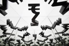 Символ валюты индийской рупии с много отражая изображений себя стоковое изображение rf