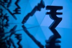 Символ валюты индийской рупии с много отражая изображений себя стоковая фотография rf
