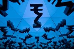 Символ валюты индийской рупии с много отражая изображений себя стоковое фото rf